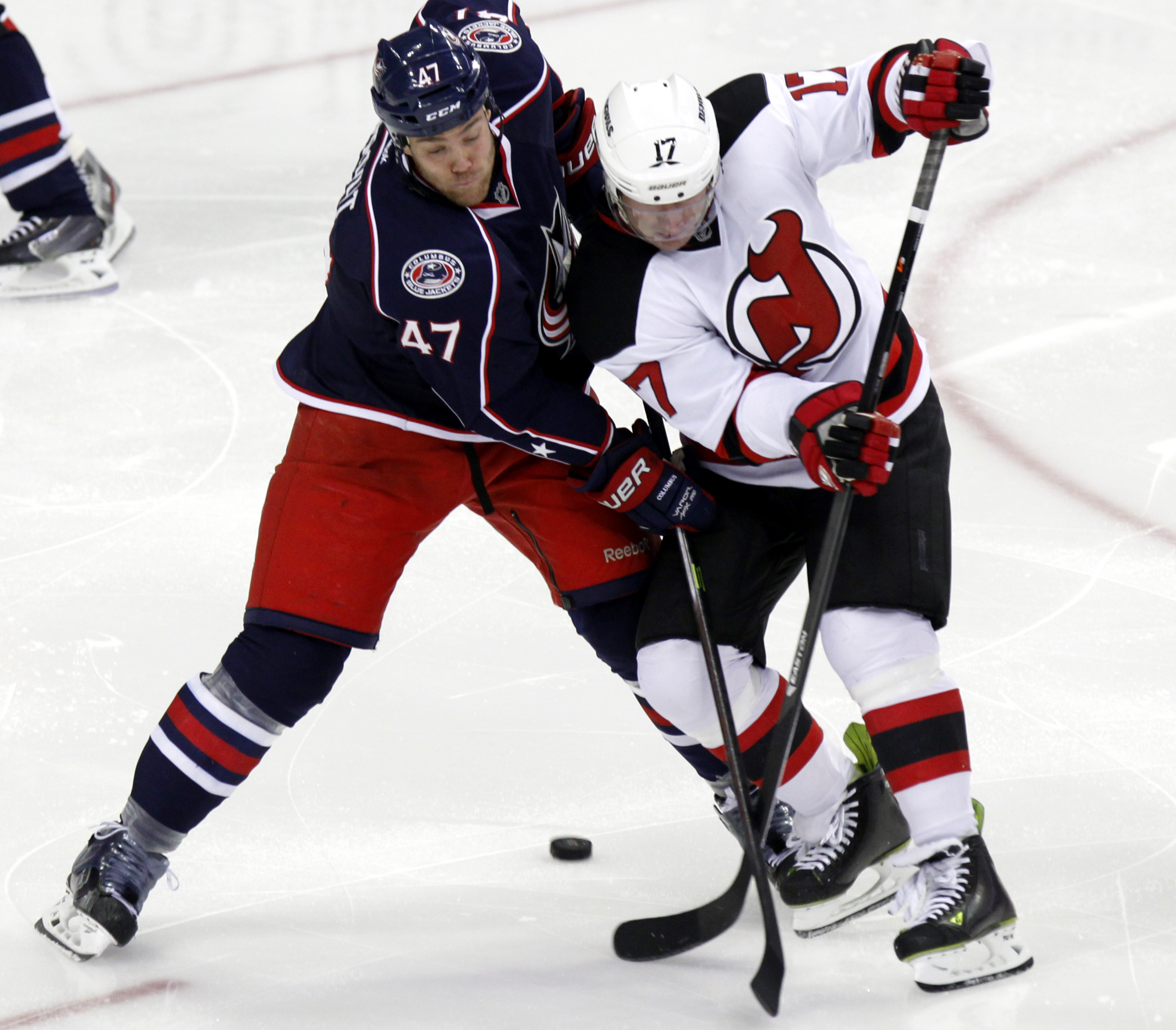 New Jersey Devils' Michael Ryder, right, works for the puck against Columbus Blue Jackets' Dalton Prout in the third period of an NHL hockey game in Columbus, Ohio, Tuesday, Oct. 22, 2013. The Blue Jackets won 4-1