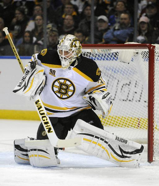 Boston Bruins goaltender Chad Johnson makes a blocker save during the first period of an NHL hockey game against the Buffalo Sabres in Buffalo, N.Y., Wednesday, Oct. 23, 2013