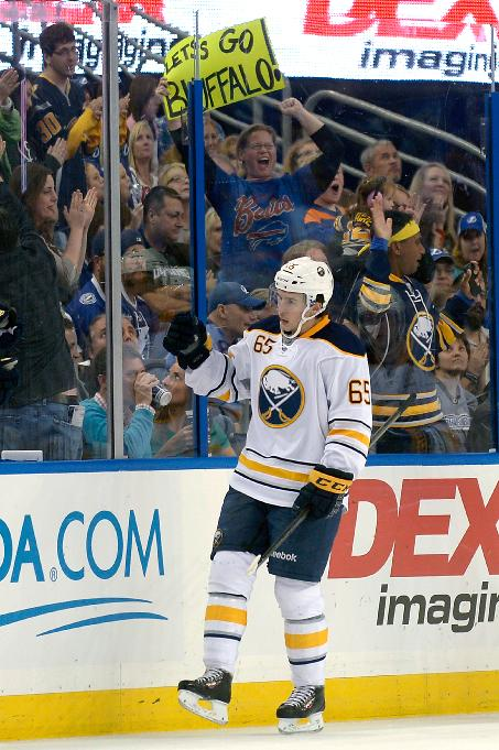 Buffalo Sabres right wing Brian Flynn (65) celebrates after scoring during the second period of an NHL hockey game against the Tampa Bay Lightning in Tampa, Fla., Saturday, Oct. 26, 2013
