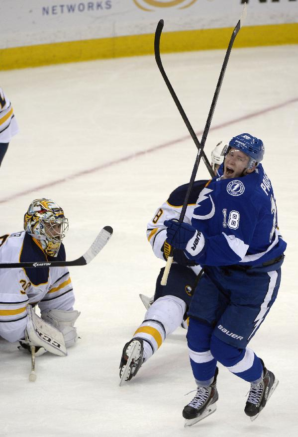 Tampa Bay Lightning left wing Ondrej Palat (18) celebrates after scoring an NHL hockey game-winning goal past Buffalo Sabres goalie Ryan Miller, left, and center Cody McCormick (8) during the third period  in Tampa, Fla., Saturday, Oct. 26, 2013. The Lightning won 3-2