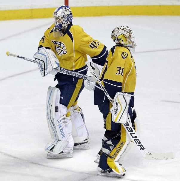 Nashville Predators goalie Magnus Hellberg (45), of Sweden, replaces Carter Hutton (30) in the third period of an NHL hockey game against the St. Louis Blues, Saturday, Oct. 26, 2013, in Nashville, Tenn. The Blues won 6-1