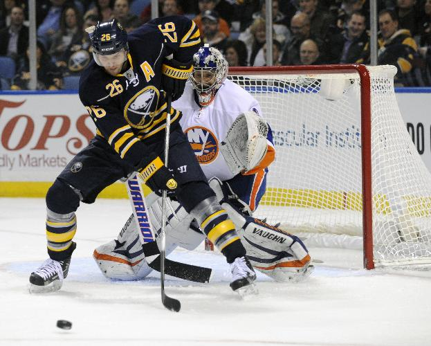 FILE-Buffalo Sabres' left winger Thomas Vanek (26), of Austria, gets ready to deflect the puck in front of New York Islanders' goaltender Evgeni Nabokov (20), of Russia, during the first period of an NHL hockey game in Buffalo, N.Y., Saturday, Feb. 23, 2013 The New York Islanders announced Sunday Oct. 27, 2013, that they have acquired Vanek from the Buffalo Sabres in exchange for Matt Moulson, a first round selection in the 2014 NHL draft and a second round selection in 2015