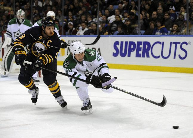 Buffalo Sabres'  Steve Ott (9) battles for the puck with Dallas Stars'  Cody Eakin (20) during the first period of an NHL hockey game in Buffalo, N.Y., Monday, Oct. 28, 2013
