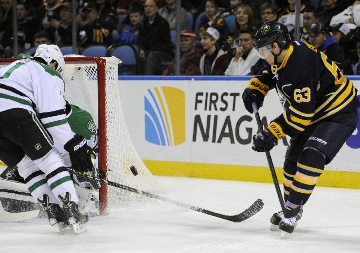 Buffalo Sabres'  Tyler Ennis (63) shoots at the Dallas Stars' net during the first period of an NHL hockey game in Buffalo, N.Y., Monday, Oct. 28, 2013