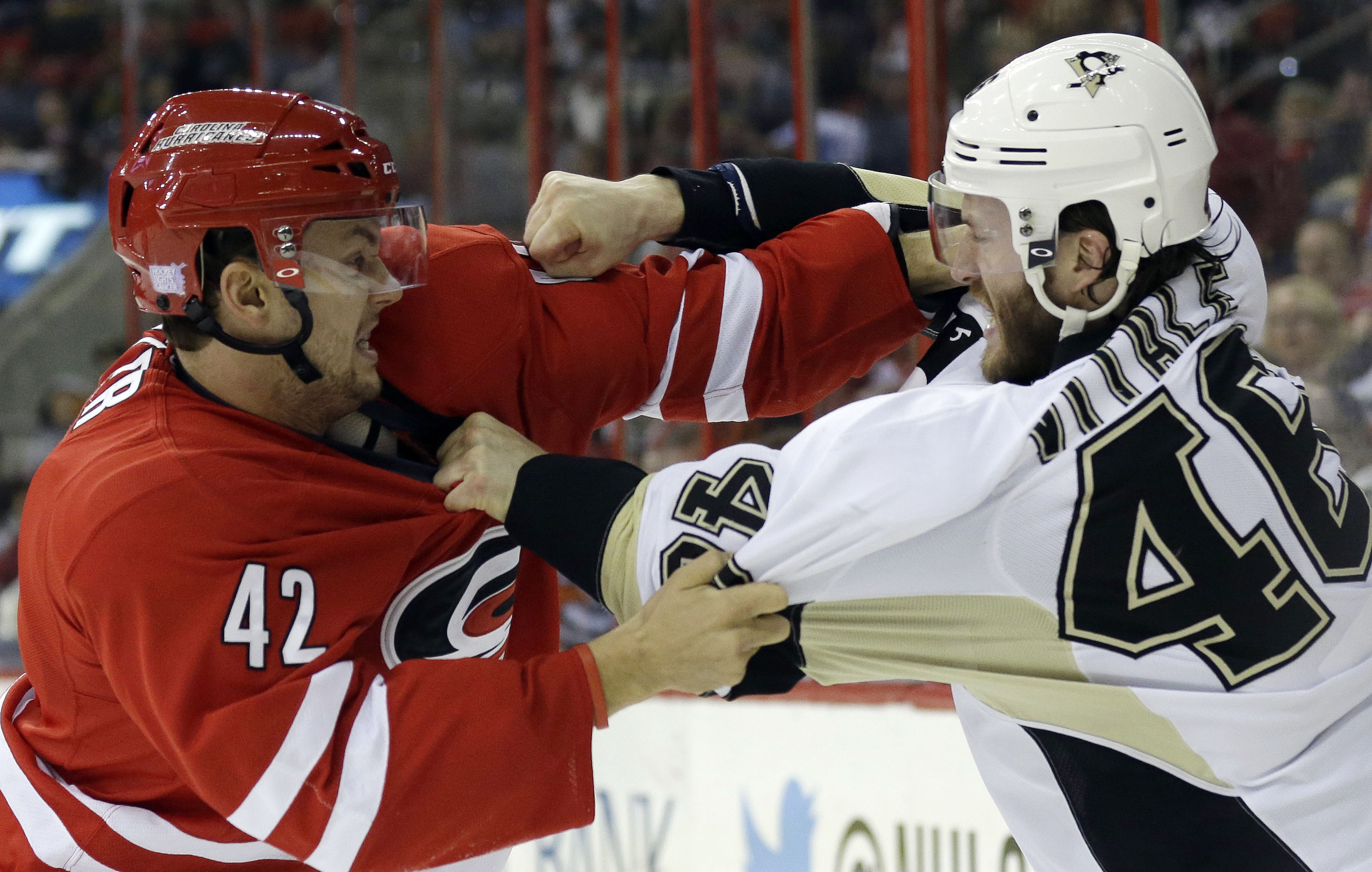 Carolina Hurricanes' Brett Sutter, left, and Pittsburgh Penguins' Joe Vitale, right, fight during the first period of an NHL hockey game in Raleigh, N.C., Monday, Oct. 28, 2013