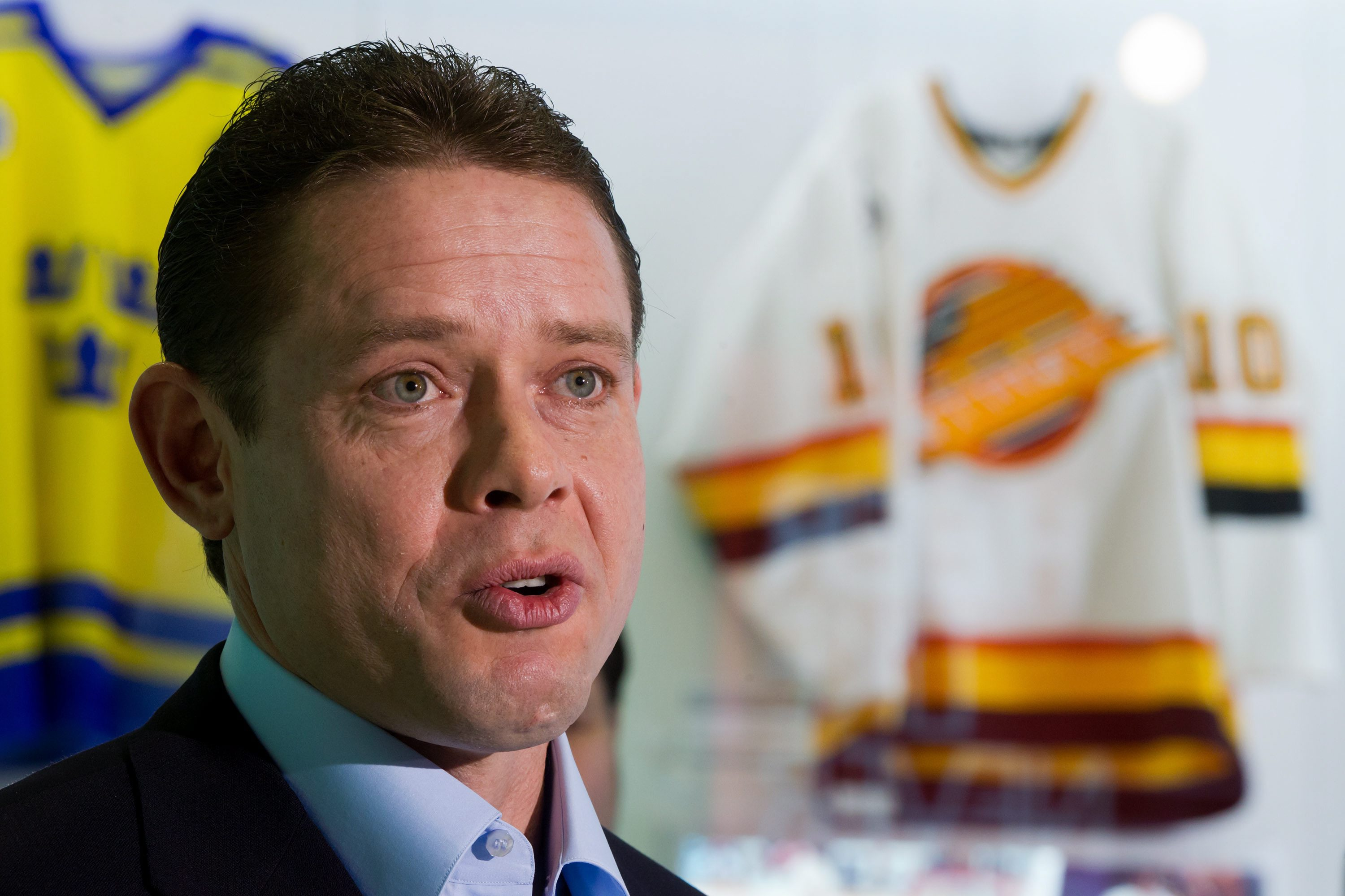 Retired Vancouver Canucks forward Pavel Bure, of Russia, speaks after the NHL hockey team inducted him into their