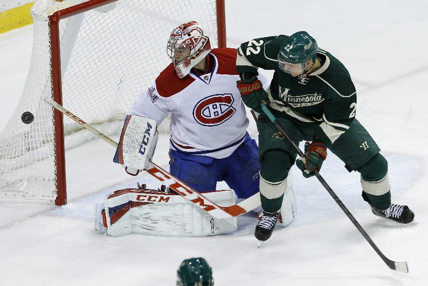 Minnesota Wild right wing Nino Niederreiter (22), of Switzerland, watches as Montreal Canadiens goalie Carey Price (31) deflects a shot during the first period of an NHL hockey game in St. Paul, Minn., Friday, Nov. 1, 2013