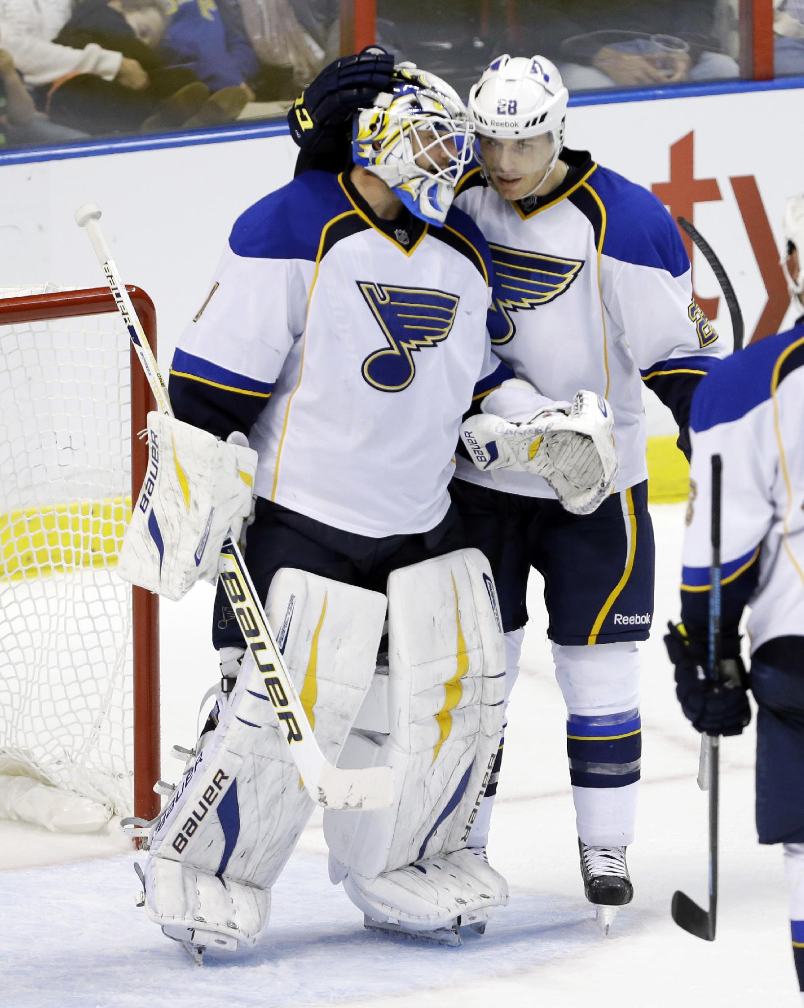 St. Louis Blues goalie Brian Elliott, left, is congratulated by Ian Cole after the Blues defeated the Florida Panthers 4-0 during the third period of an NHL hockey game Friday, Nov. 1, 2013, in Sunrise, Fla