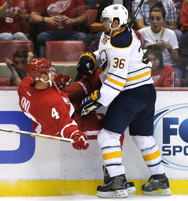 Buffalo Sabres right wing Patrick Kaleta (36) checks Detroit Red Wings defenseman Jakub Kindl (4) during the first period of an NHL hockey game in Detroit, Wednesday, Oct. 2, 2013