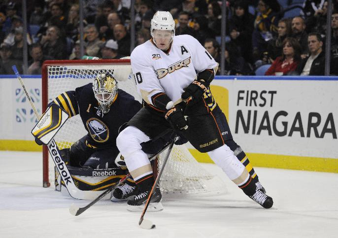 Anaheim Ducks right winger Corey Perry (10) moves the puck in front of Buffalo Sabres goaltender Jhonas Enroth (1), of Sweden, during the second period of an NHL hockey game in Buffalo, N.Y., Saturday, Nov. 2, 2013