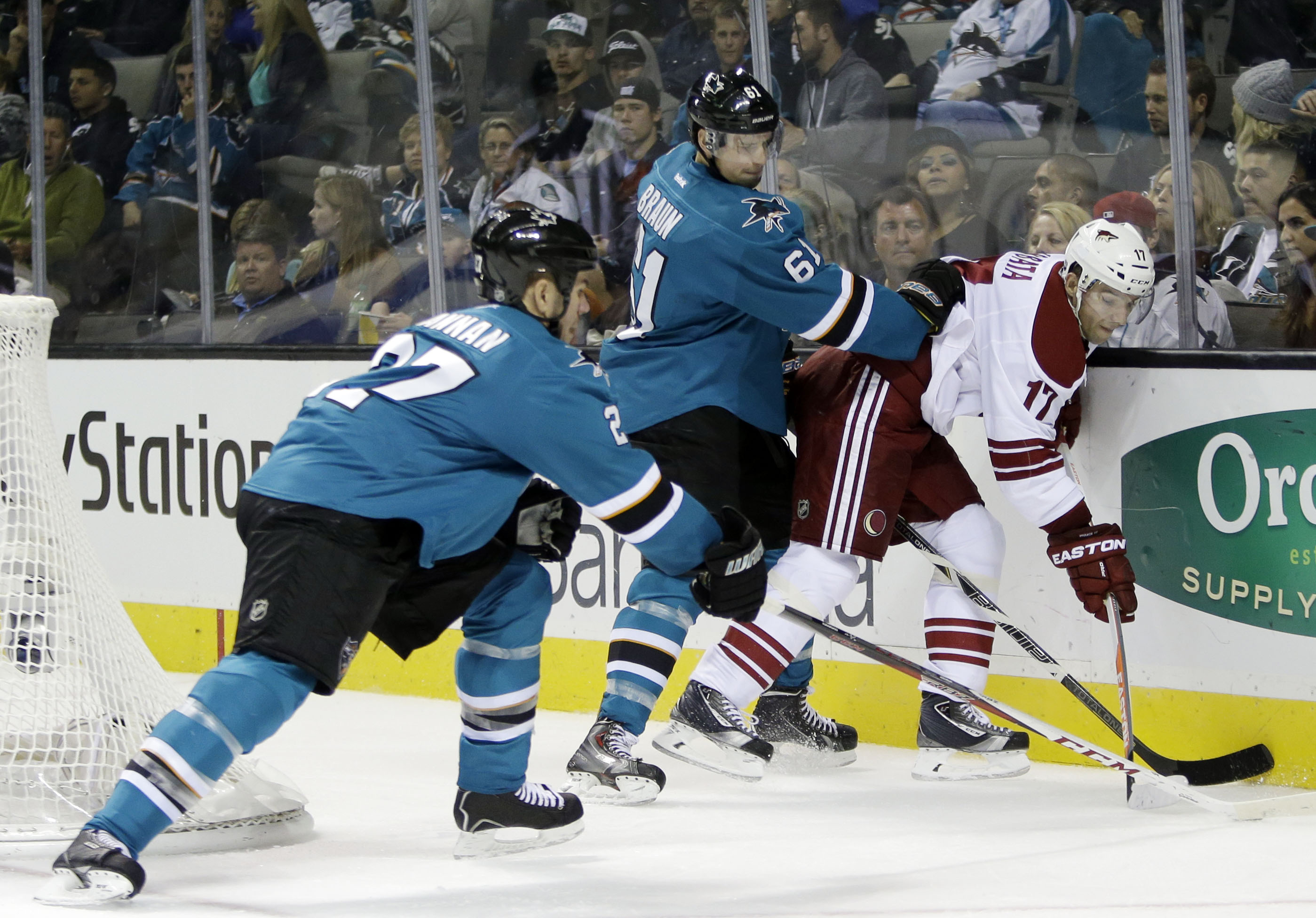 Phoenix Coyotes' Radim Vrbata (17), of the Czech Republic, is defended by San Jose Sharks' Justin Braun (61) and Scott Hannan (27) during the second period of an NHL hockey game on Saturday, Nov. 2, 2013, in San Jose, Calif