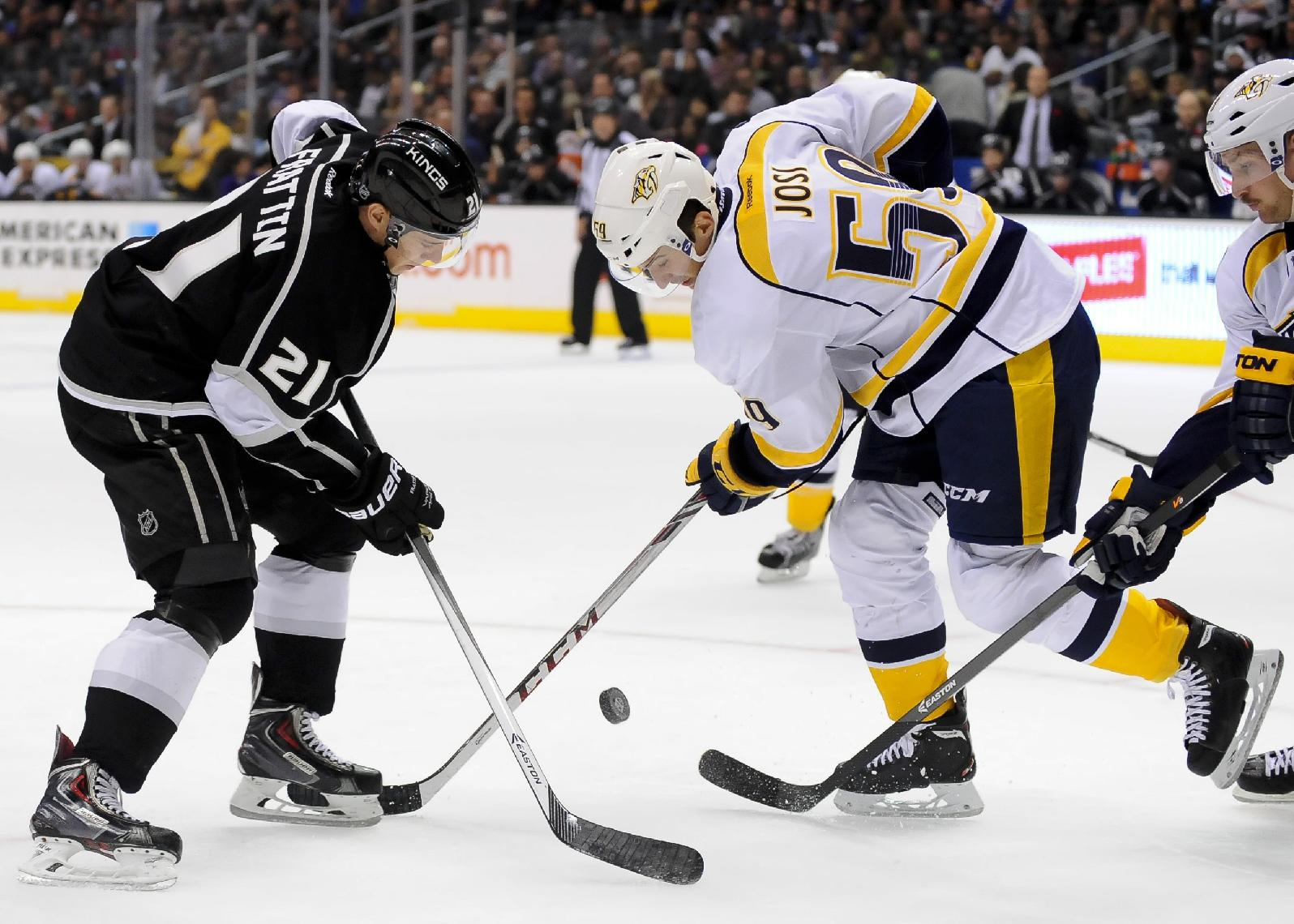 Nashville Predators defenseman Roman Josi (59), of Switzerland, attempts to get the puck by Los Angeles Kings right wing Matt Frattin (21) during the second period of their NHL hockey game on Saturday, Nov. 2, 2013, in Los Angeles. The Predators won 4-3