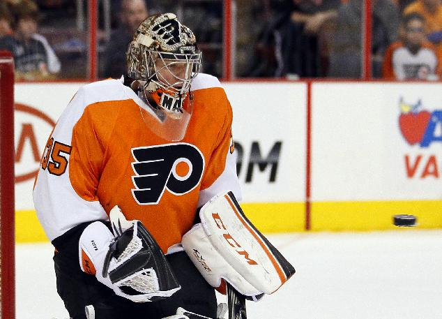 Philadelphia Flyers goalie Steve Mason eyes the puck coming toward him during the first period of an NHL hockey game against the Edmonton Oilers,  Saturday, Nov. 9, 2013, in Philadelphia