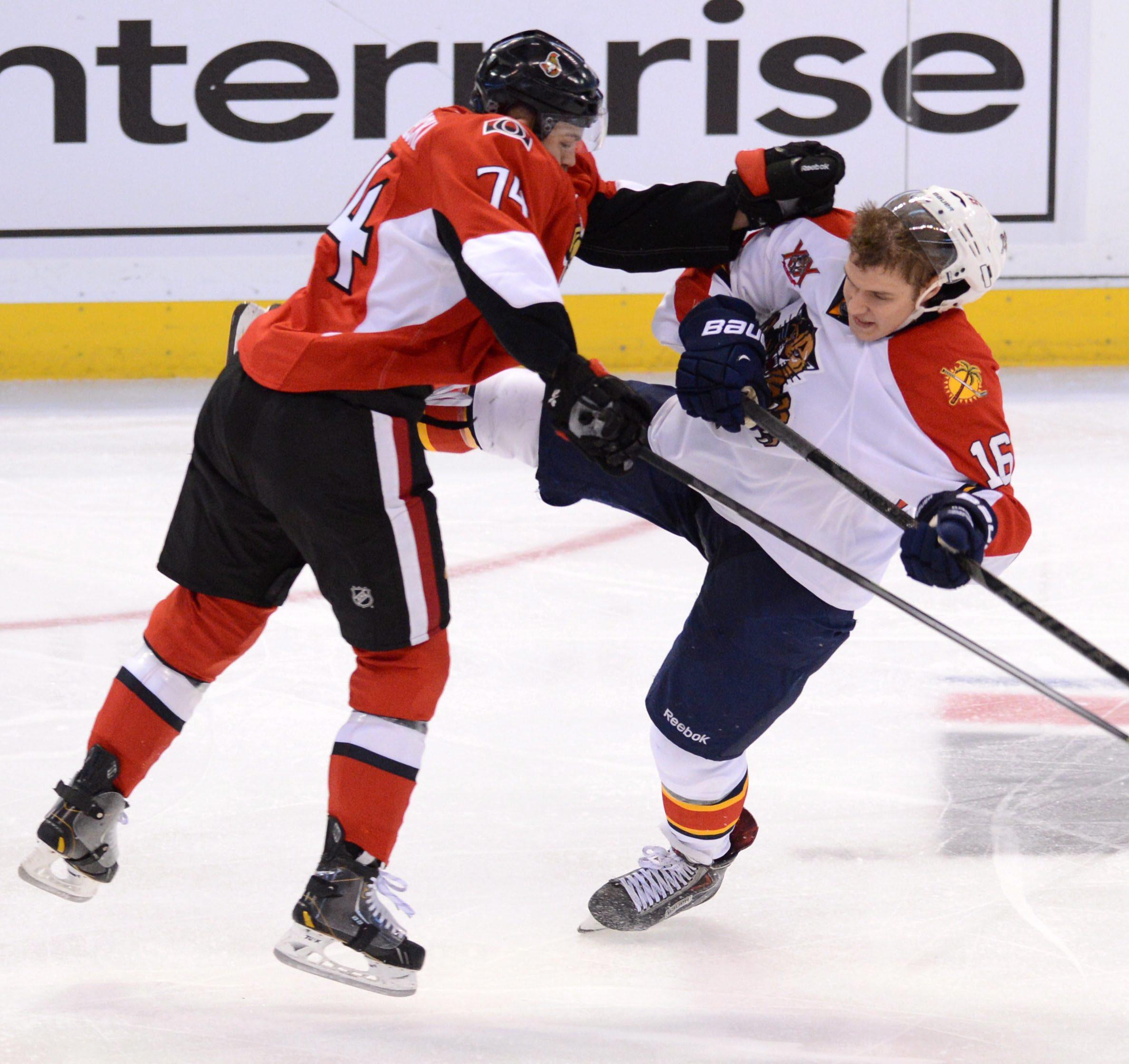Ottawa Senators' Mark Borowiecki hits Florida Panthers' Aleksander Barkov during second period of an NHL hockey game in Ottawa, Ontario, on Saturday, Nov. 9, 2013