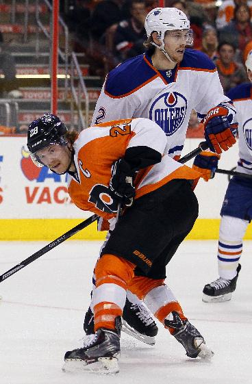 Philadelphia Flyers' Claude Giroux makes contact with Edmonton Oilers' Jeff Petry during the second period of an NHL hockey game, Saturday, Nov. 9, 2013, in Philadelphia. The Flyers won 4-2
