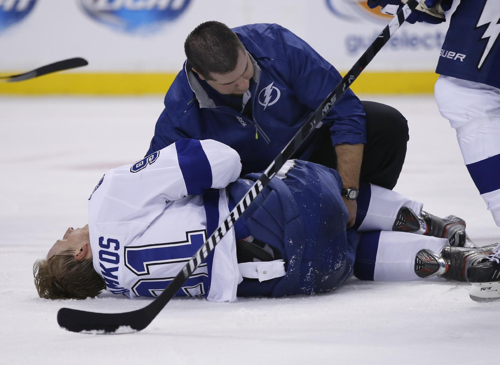 Tampa Bay Lightning center Steven Stamkos is attended to on the ice after banging into the goalpost during the second period of an NHL hockey game against the Boston Bruins in Boston Monday, Nov. 11, 2013. Stamkos was taken off the ice on a stretcher after the play