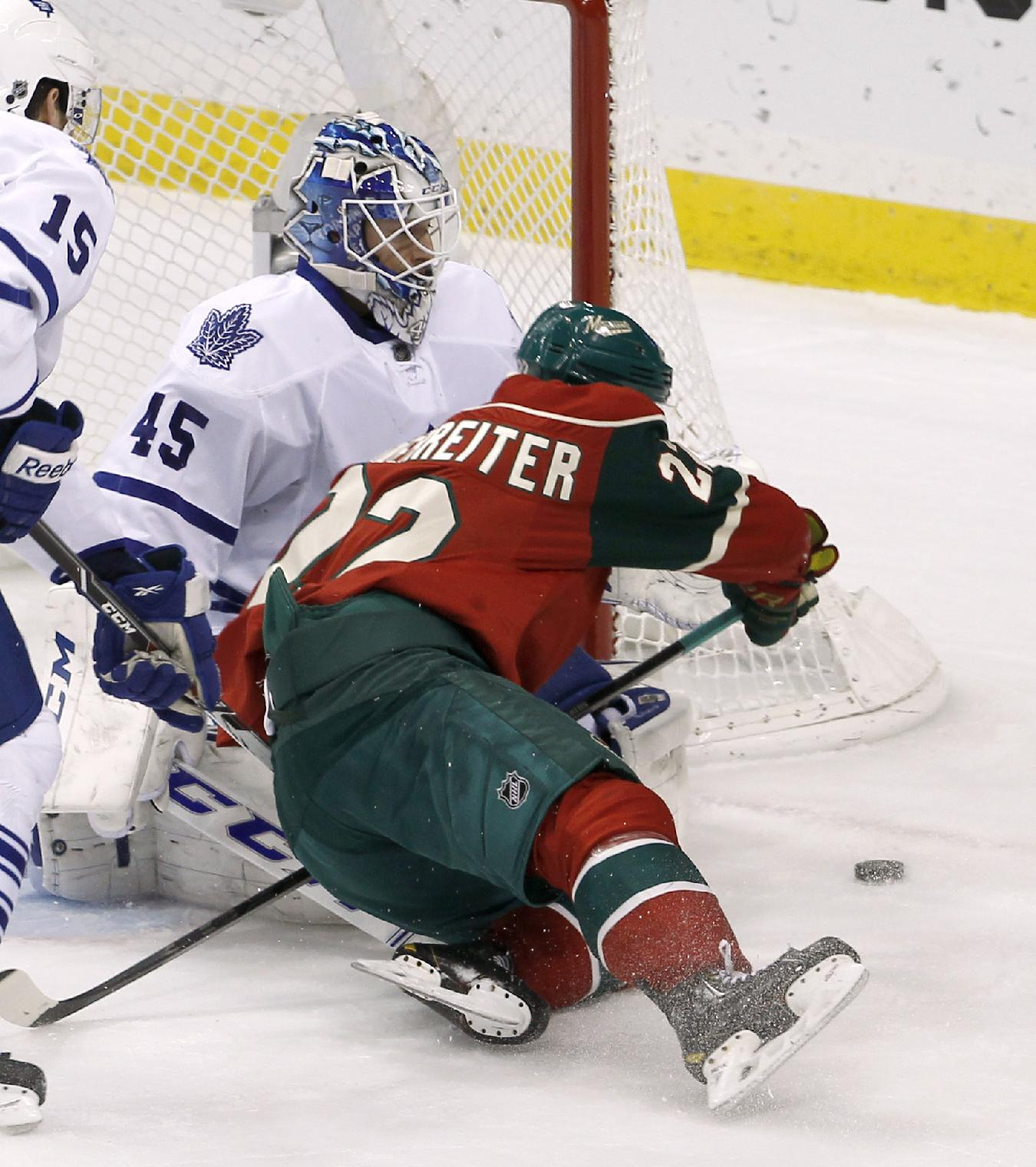 Minnesota Wild right wing Nino Niederreiter, right, of Switzerland, collides with Toronto Maple Leafs goalie Jonathan Bernier while chasing the puck during the first period of an NHL hockey game in St. Paul, Minn., Wednesday, Nov. 13, 2013