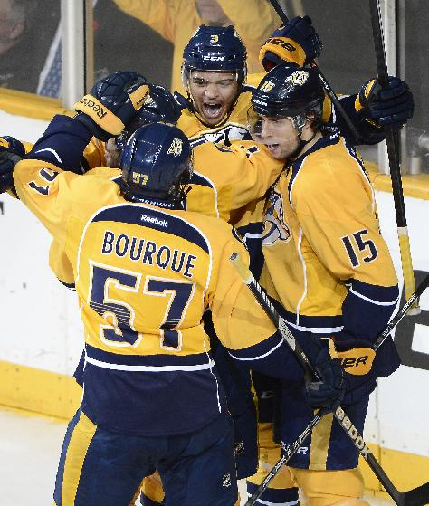 Nashville Predators defenseman Seth Jones (3), forward Gabriel Bourque (57) and forward Craig Smith (15) celebrate after forward Matt Cullen (7) scored a goal against the Chicago Blackhawks in the first period of an NHL hockey game Saturday, Nov. 16, 2013, in Nashville, Tenn