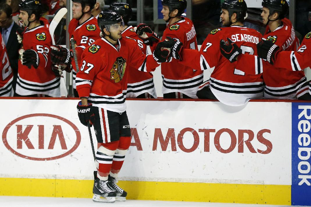 Chicago Blackhawks center Brandon Pirri (37) celebrates scoring a goal against the San Jose Sharks during the first period of an NHL hockey game on Sunday, Nov. 17, 2013, in Chicago