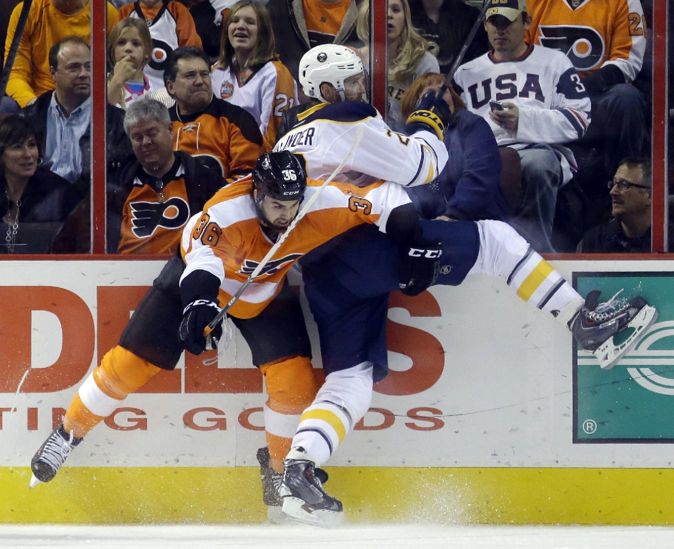 Philadelphia Flyers' Zac Rinaldo, left, collides with Buffalo Sabres' Henrik Tallinder, of Sweden, during the first period of an NHL hockey game Thursday, Nov. 21, 2013, in Philadelphia