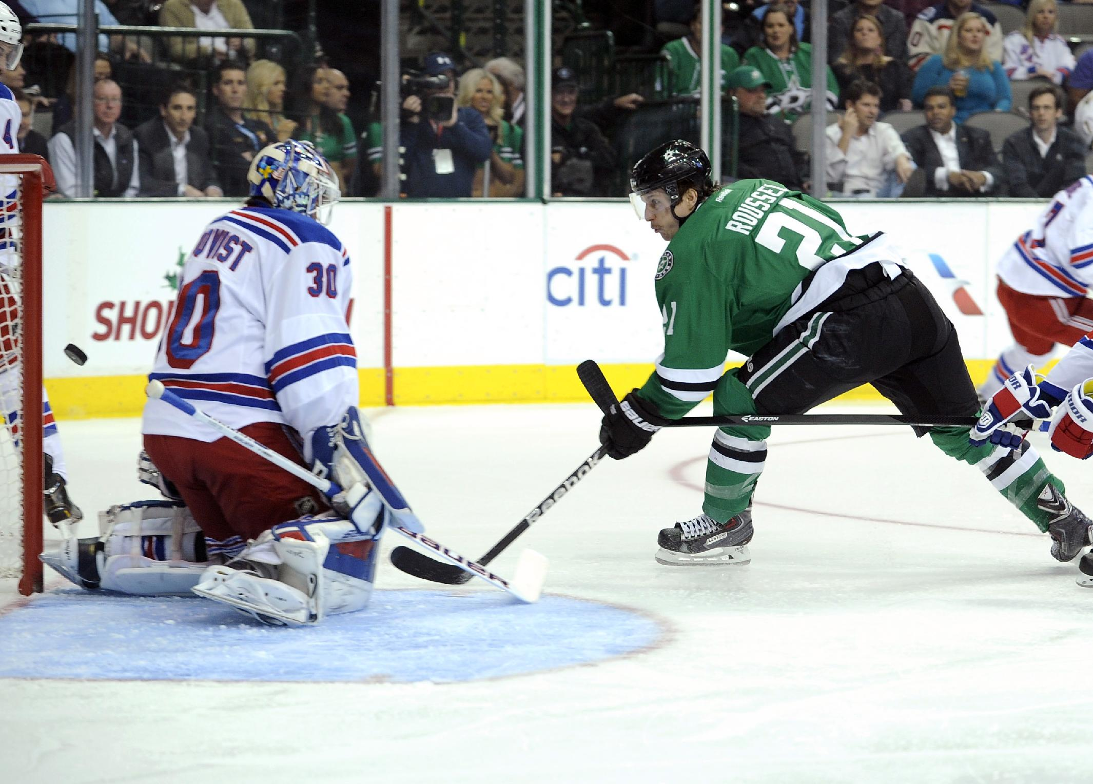Dallas Stars left wing Antoine Roussel (21) gets a shot off wide of New York Rangers goalie Henrik Lundqvist (30) during the first period of an NHL hockey game, Thursday Nov. 21, 2013 in Dallas