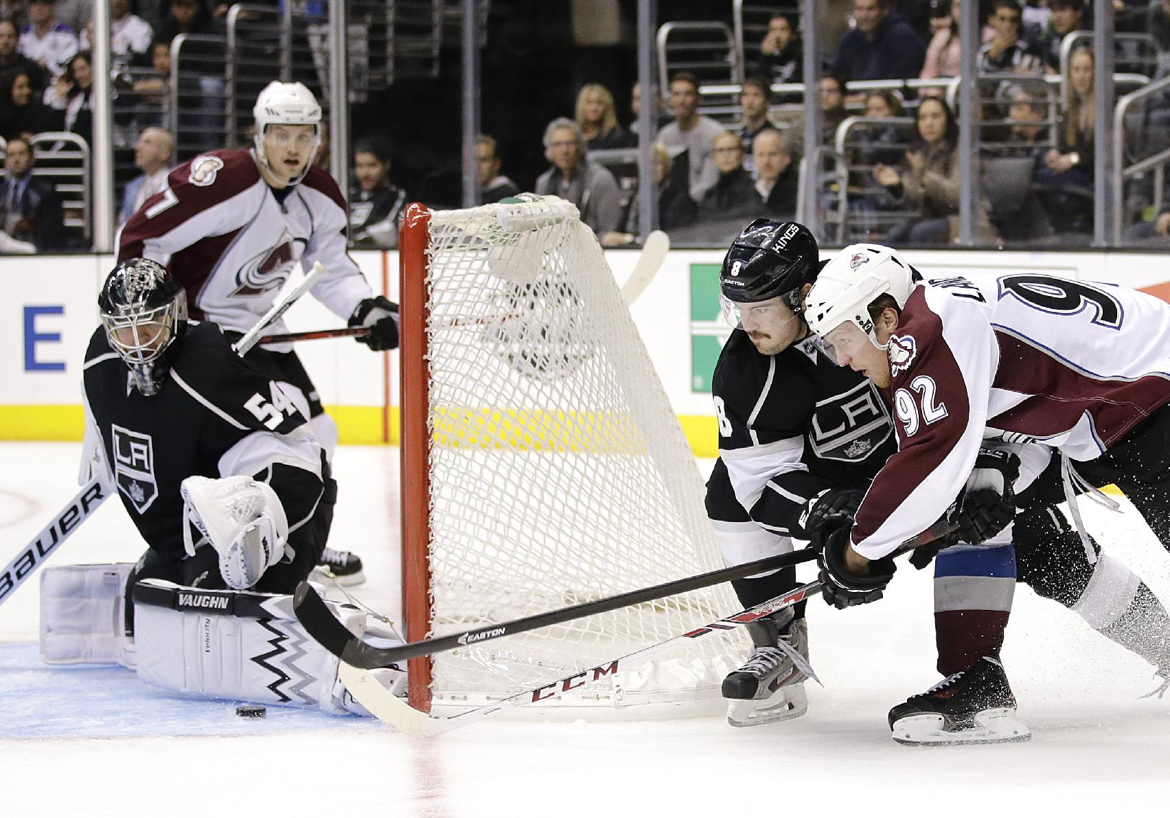 Colorado Avalanche's Gabriel Landeskog(92), of Sweden, tries to score against Los Angeles Kings goalie Ben Scrivens(54) as he is defended by Los Angeles Kings' Drew Doughty(8) during the third period of an NHL hockey game on Saturday, Nov. 23, 2013, in Los Angeles. The Avalanche won 1-0 in overtime