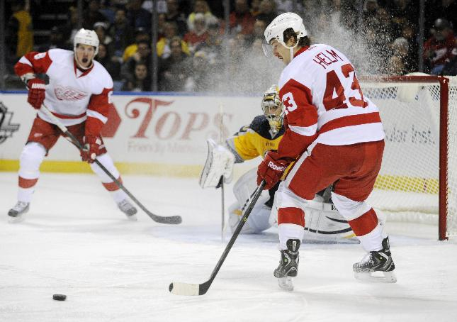 Detroit Red Wings' Justin Abdelkader (8), passes the puck out to Darren Helm (43) as Buffalo Sabres' Ryan Miller (30) looks on during the second period of an NHL hockey game in Buffalo, N.Y., Sunday, Nov. 24, 2013.  Detroit won 3-1