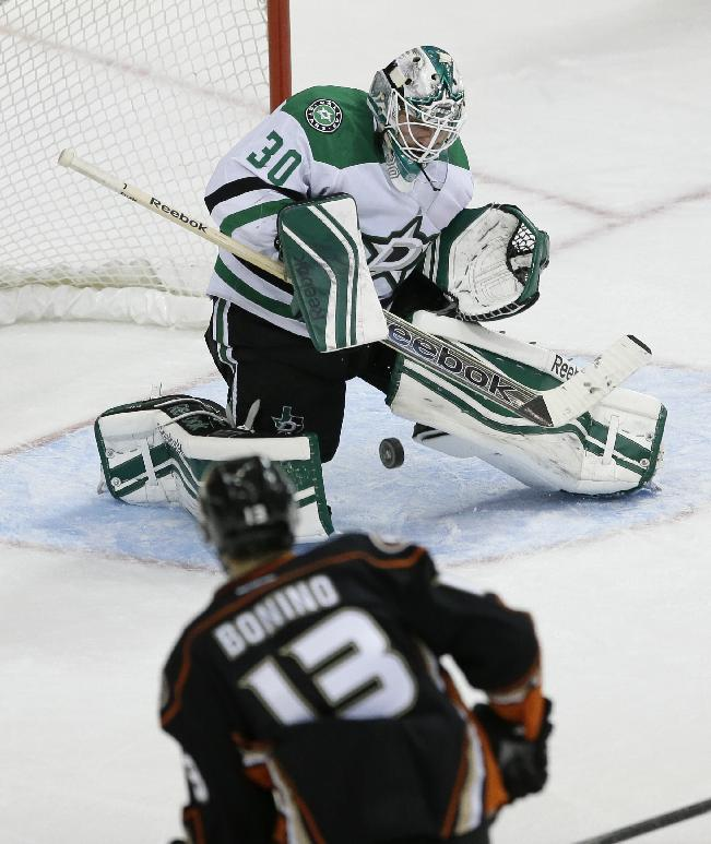 Dallas Stars goalie Dan Ellis (30) blocks a shot from Anaheim Ducks center Nick Bonino (13) during the second period of an NHL hockey game in Dallas, Tuesday, Nov. 26, 2013