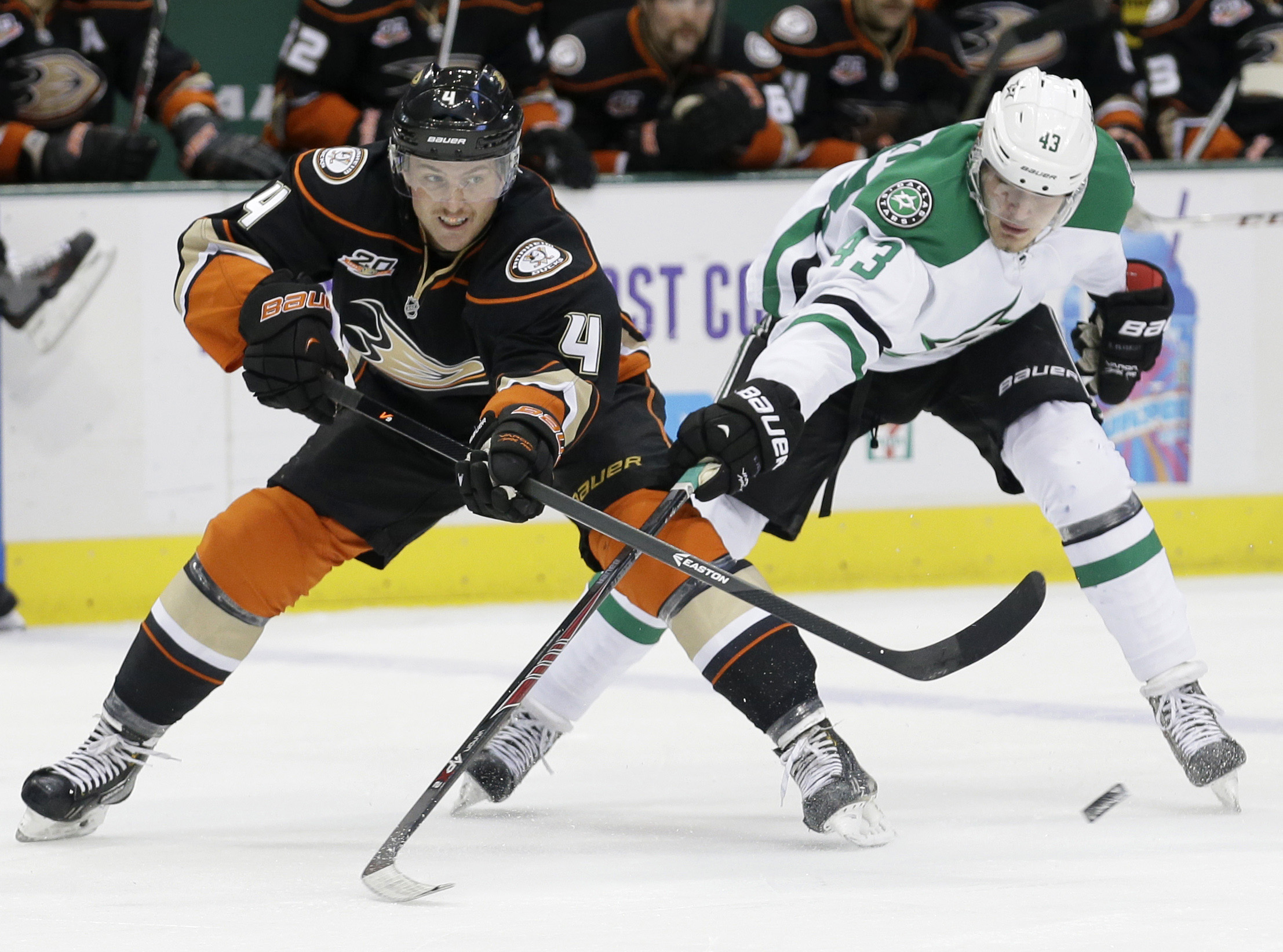Anaheim Ducks defenseman Cam Fowler (4) passes the puck as Dallas Stars right wing Valeri Nichushkin (43) tries to block during the first period of an NHL hockey game in Dallas, Tuesday, Nov. 26, 2013