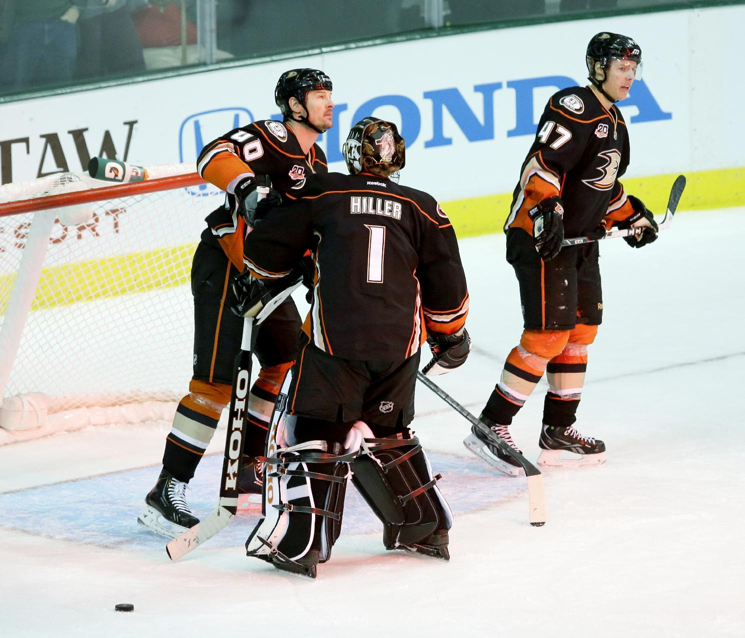 Anaheim Ducks goalie Jonas Hiller (1), defensemen Nolan Yonkman (40) and Hampus Lindholm (47) react after Dallas Stars left wing Antoine Roussel (21) scored a goal during the third period of an NHL hockey game in Dallas, Tuesday, Nov. 26, 2013.  Dallas won the game 6-3