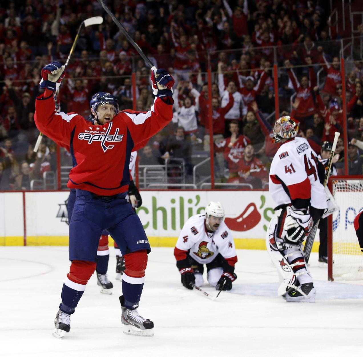 Washington Capitals right wing Eric Fehr (16) celebrates his goal past Ottawa Senators goalie Craig Anderson (41) in the first period of an NHL hockey game, Wednesday, Nov. 27, 2013, in Washington