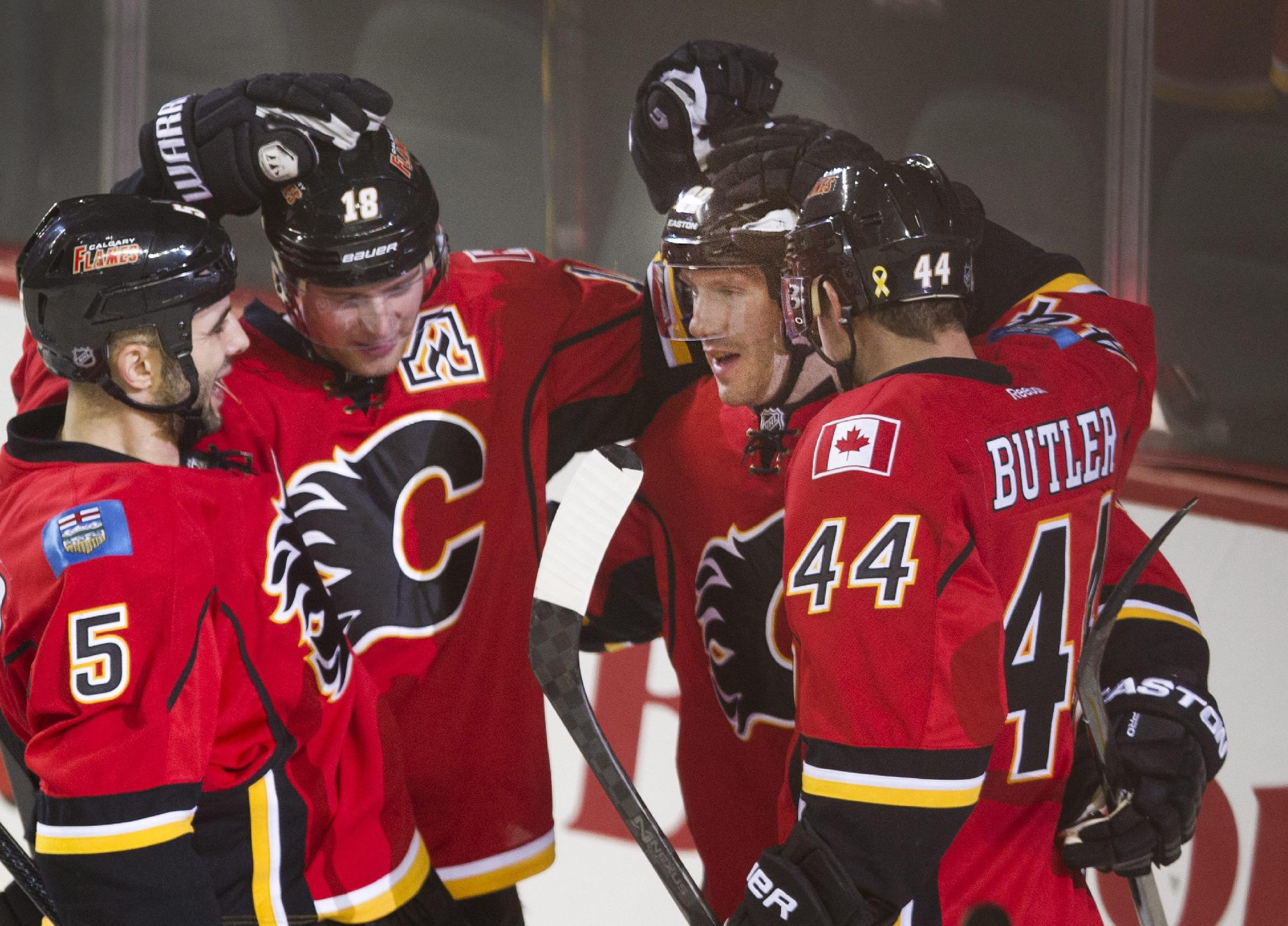 Calgary Flames' Lee Stempniak, second from right, celebrates his short-handed goal against the Phoenix Coyotes with Mark Giordano, left, Matt Stajan, second from left, and Chris Butler during third period NHL action Wednesday, Dec. 4, 2013 in Calgary, Alberta