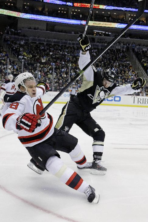 Pittsburgh Penguins' Zach Sill, right, collides with New Jersey Devils' Anton Volchenkov during the second period of an NHL hockey game in Pittsburgh, Friday, Dec. 13, 2013