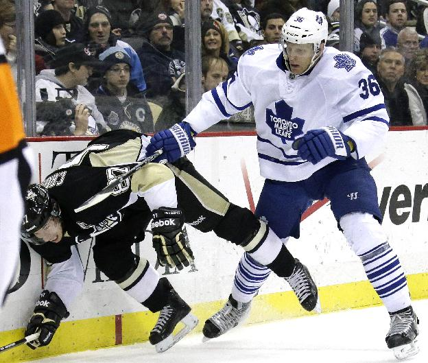 Toronto Maple Leafs' Carl Gunnarsson (36) collides with Pittsburgh Penguins' Sidney Crosby (87) during the second period of an NHL hockey game in Pittsburgh, Monday, Dec. 16, 2013