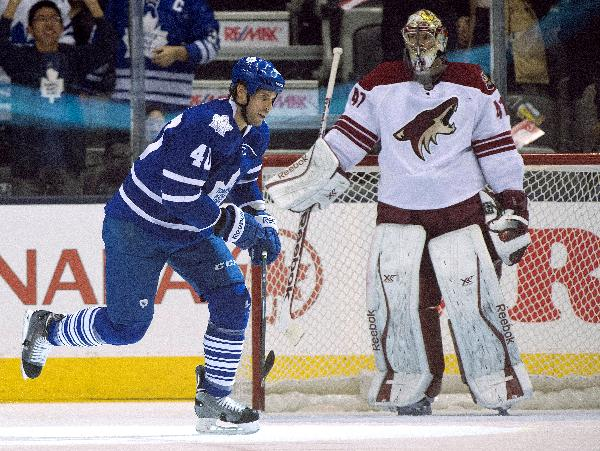 Toronto Maple Leafs right winger Troy Bodie (40) celebrates after scoring after scoring on Phoenix Coyotes goaltender Mike Smith during the first period of an NHL hockey game action in Toronto on Thursday, Dec. 19, 2013