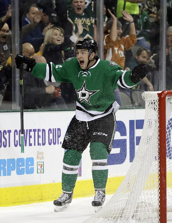 Dallas Stars center Colton Sceviour celebrates his goal against the Vancouver Canucks during the first period of an NHL hockey game, Thursday, Dec. 19, 2013, in Dallas