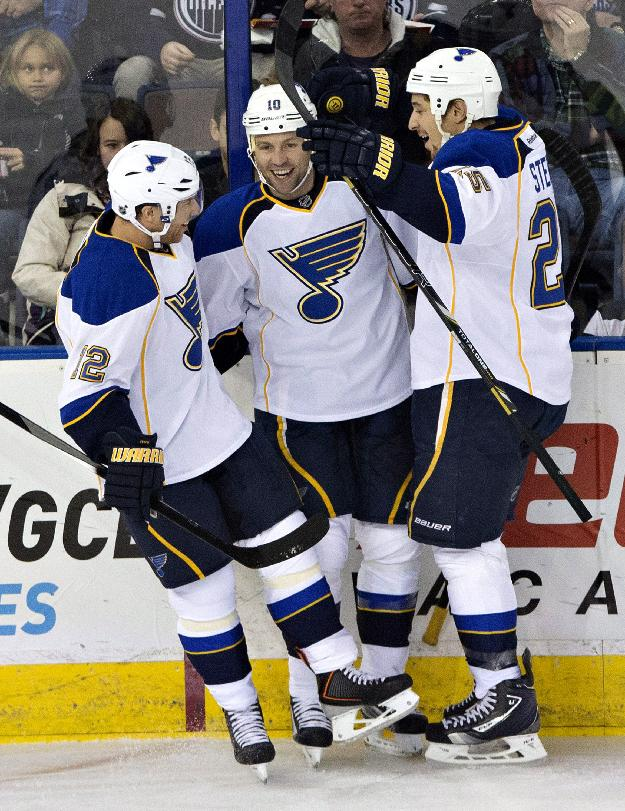 St. Louis Blues' Derek Roy (12), Brenden Morrow (10) and Chris Stewart (25) celebrate after scoring against the Edmonton Oilers during the second period of an NHL hockey game in Edmonton, Alberta, on Saturday, Dec. 21, 2013