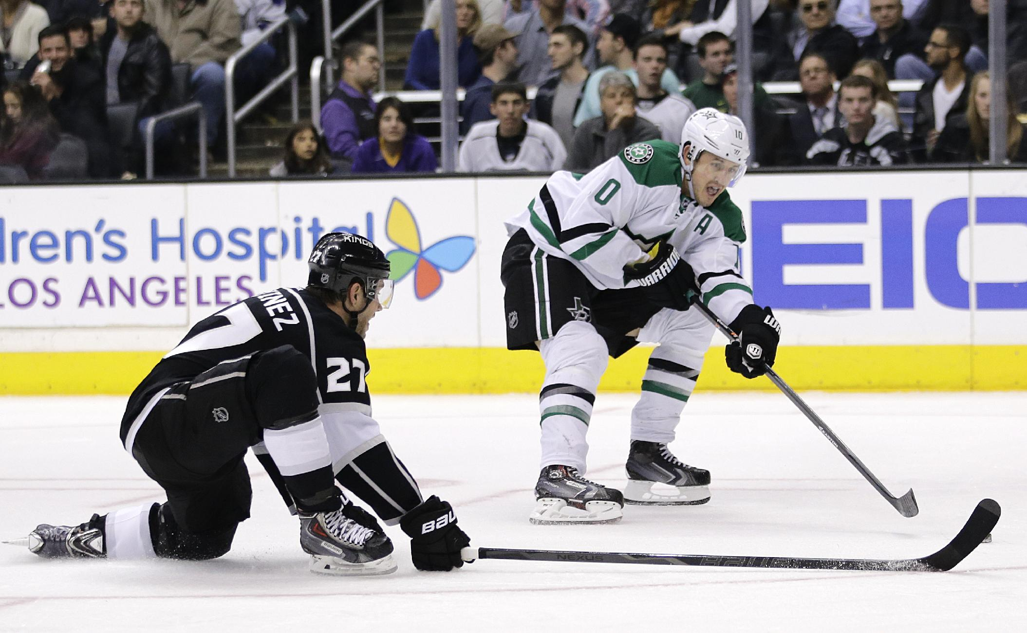 Dallas Stars' Shawn Horcoff, right, tries to score against Los Angeles Kings' Alec Martinez during the third period of an NHL hockey game on Monday, Dec. 23, 2013, in Los Angeles. The Stars won 5-2