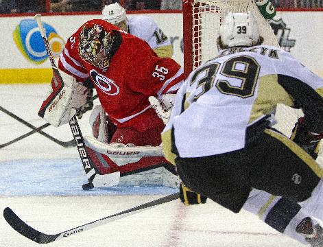 Carolina Hurricanes goalie Justin Peters (35) blocks the shot of Pittsburgh Penguins' Harry Zolnierczyk (39) during the first period of an NHL hockey game, Friday, Dec. 27, 2013, in Raleigh, N.C