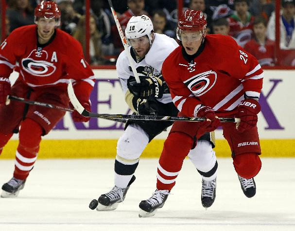 Carolina Hurricanes' Alexander Semin (28), of Russia, battles with Pittsburgh Penguins' James Neal (18) during the second period of an NHL hockey game, Friday, Dec. 27, 2013, in Raleigh, N.C
