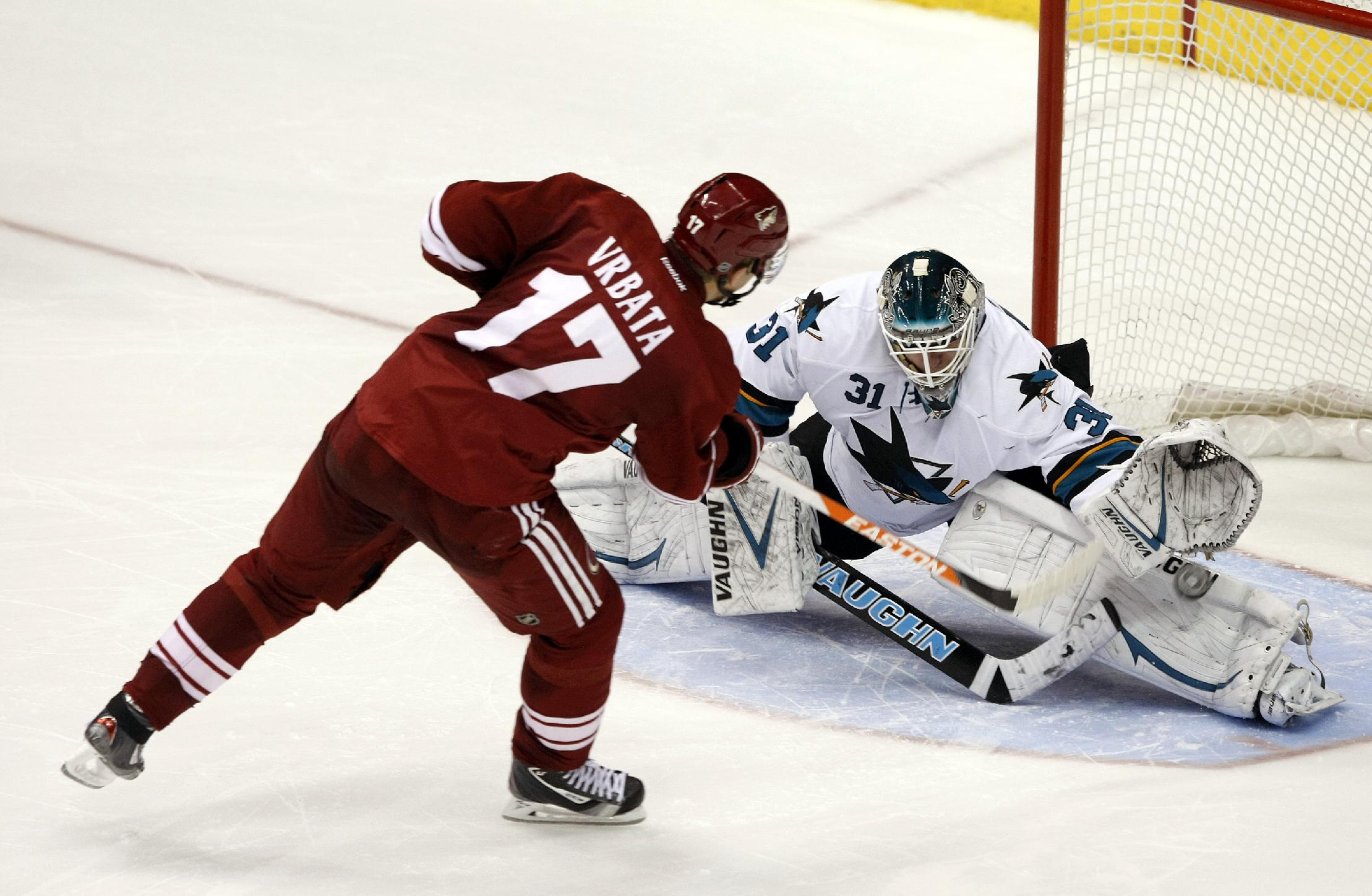 San Jose Sharks goalie Antti Niemi (31) makes the save on Phoenix Coyotes right wing Radim Vrbata (17) in a shoot-out during an NHL hockey game on Friday, Dec. 27, 2013, in Glendale, Ariz. The Sharks defeated the Coyotes in an overtime shoot-out 4-3