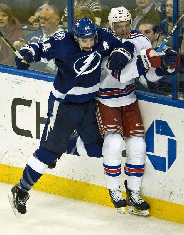 Tampa Bay Lightning's Nate Thompson (44) checks New York Rangers' Conor Allen (37) into the boards during the second period of an NHL hockey game, Sunday, Dec. 29, 2013, in Tampa, Fla