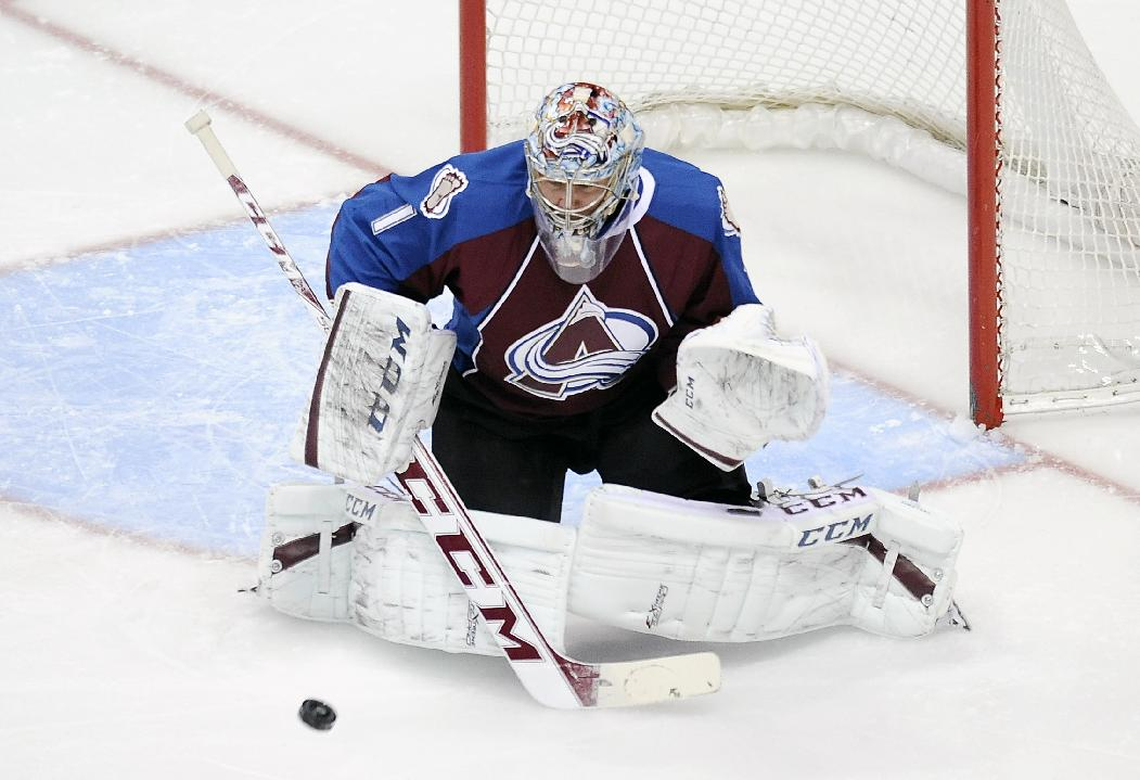 Colorado Avalanche goalie Semyon Varlamov, of Russia, makes a save in the first period of an NHL hockey game against the San Jose Sharks on Saturday, Jan. 4, 2014, in Denver