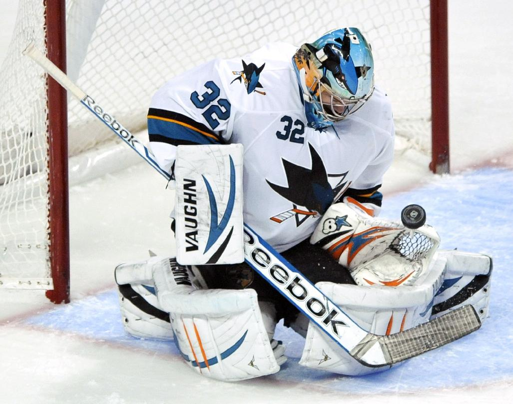 San Jose Sharks goalie Alex Stalock (32) makes a save during the third period of an NHL hockey game against the Chicago Blackhawks in Chicago, Sunday, Jan. 5, 2014. San Jose won 3-2 in a shootout