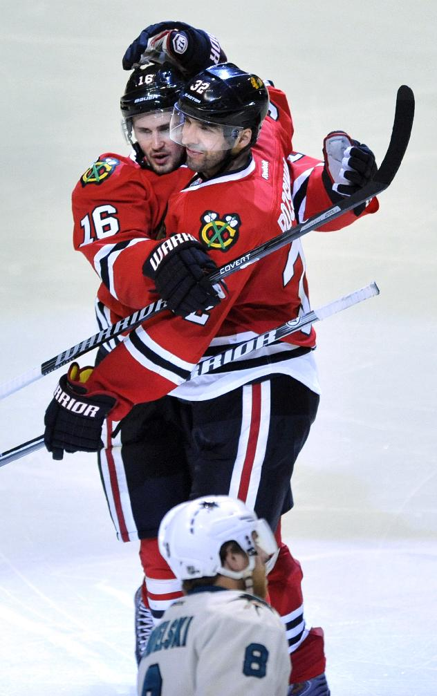Chicago Blackhawks' Michal Rozsival (32), celebrates with teammate Marcus Kruger (16), after scoring a goal during the third period of an NHL hockey game against the San Jose Sharks in Chicago, Sunday, Jan., 5, 2014. San Jose won 3-2 in a shootout