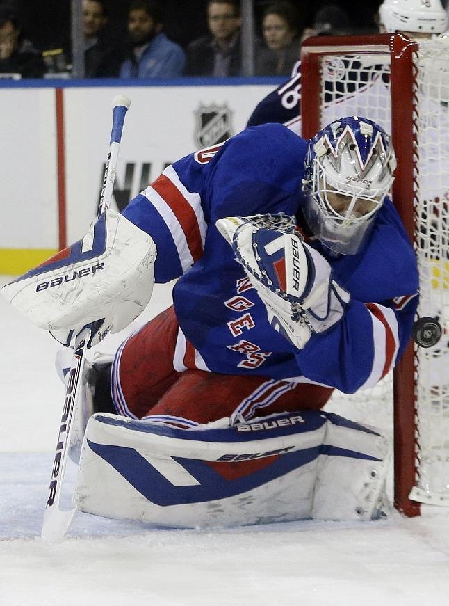 New York Rangers goalie Henrik Lundqvist (30), of Sweden, stops a shot on the goal during the first period of an NHL hockey game against the Columbus Blue Jackets, Monday, Jan. 6, 2014, in New York