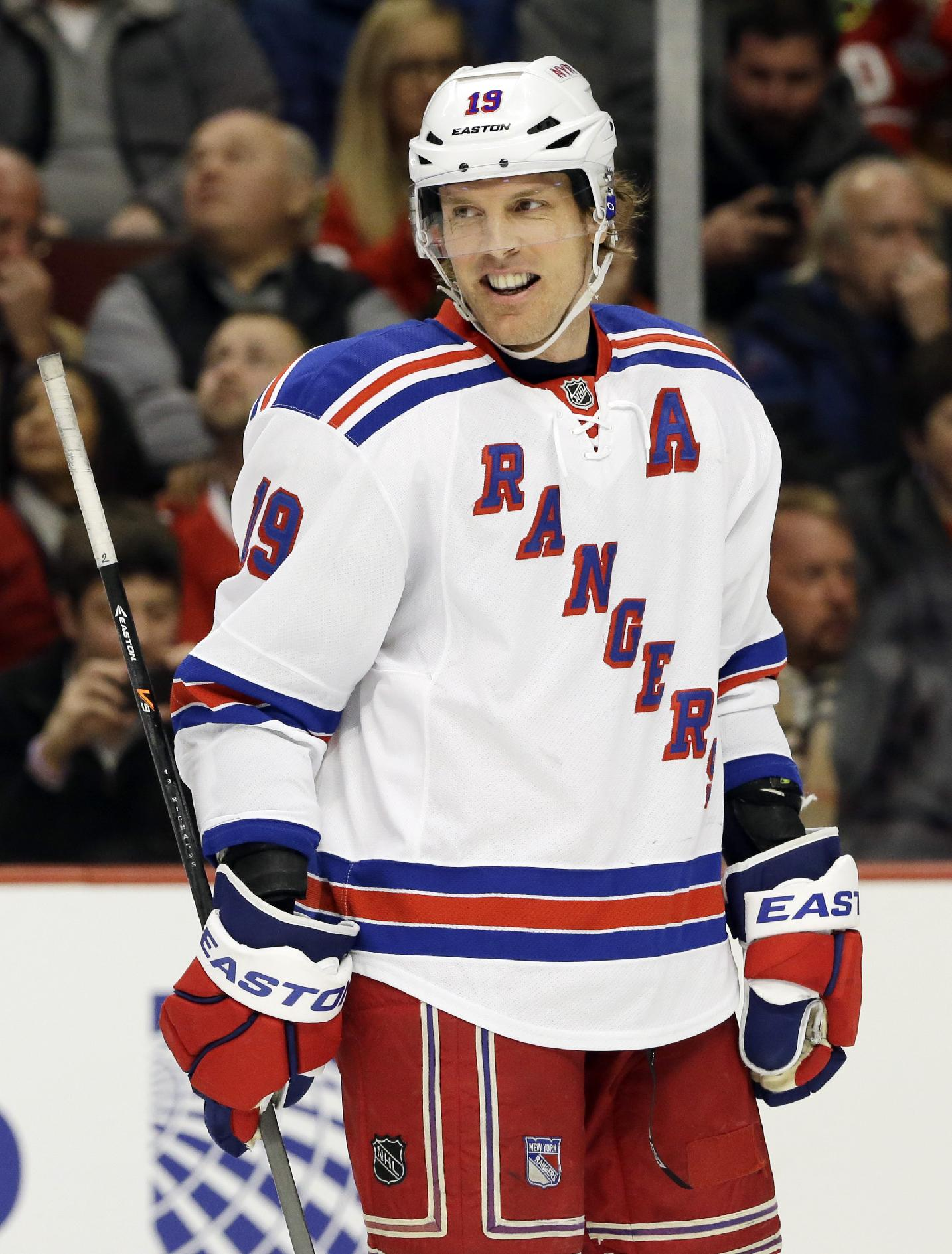 New York Rangers' Brad Richards (19) smiles as he looks to teammates during the first period of an NHL hockey game against the Chicago Blackhawks in Chicago, Wednesday, Jan. 8, 2014