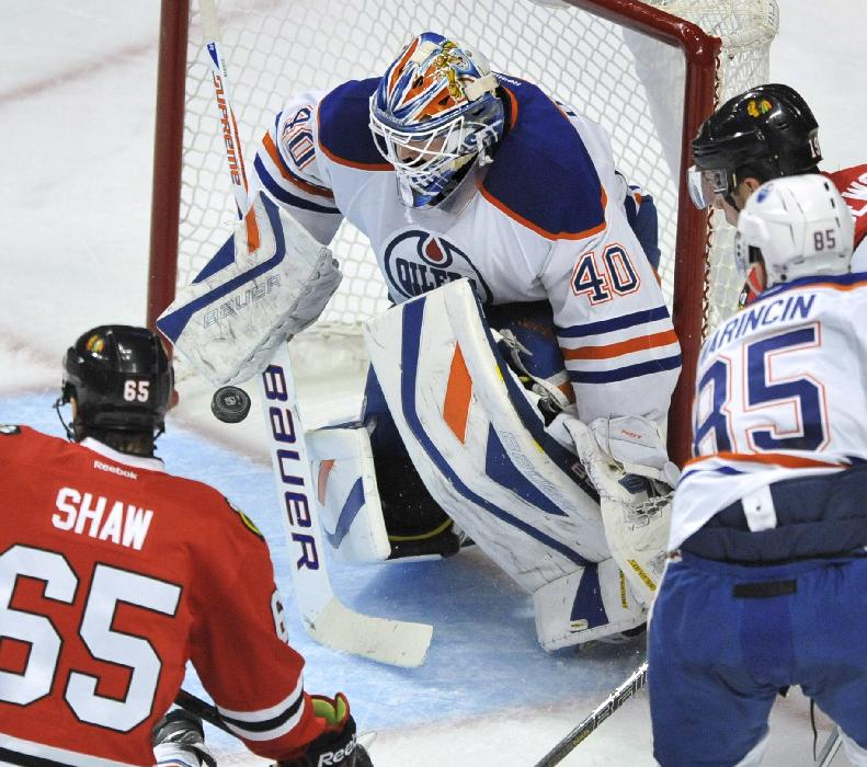 Edmonton Oilers goalie Devan Dubnyk makes a save during the second period of an NHL hockey game against the Chicago Blackhawks in Chicago, Sunday, Jan., 12, 2014. Chicago won 5-3