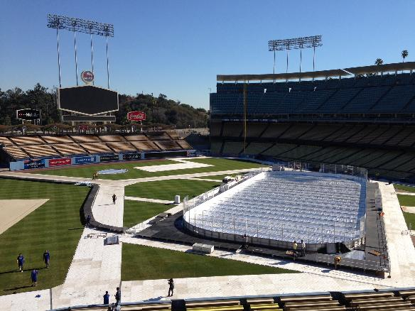 The hockey rink is ready as preparations continue on Friday, Jan. 17, 2014, in  Los Angeles, for the upcoming outdoor NHL hockey game at the Dodger Stadium, home of the Los Angeles Dodgers baseball team. The 2014 NHL Stadium Series game between the Los Angeles Kings and Anaheim Ducks is scheduled for Saturday, Jan. 25