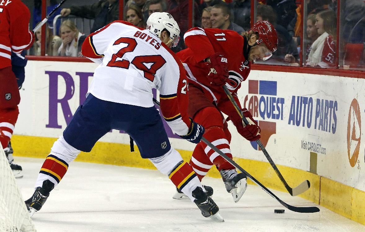 Carolina Hurricanes' Jordan Staal (11) battles with Florida Panthers' Brad Boyes (24) during the first period of an NHL hockey game in Raleigh, N.C., Saturday, Jan. 18, 2014